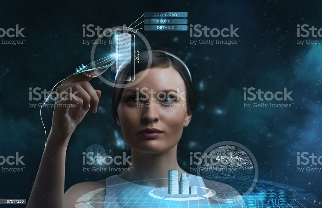 Futuristic businesswoman working with a transparent screen stock photo