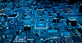 Futuristic Circuit Board. Blue with electrons.