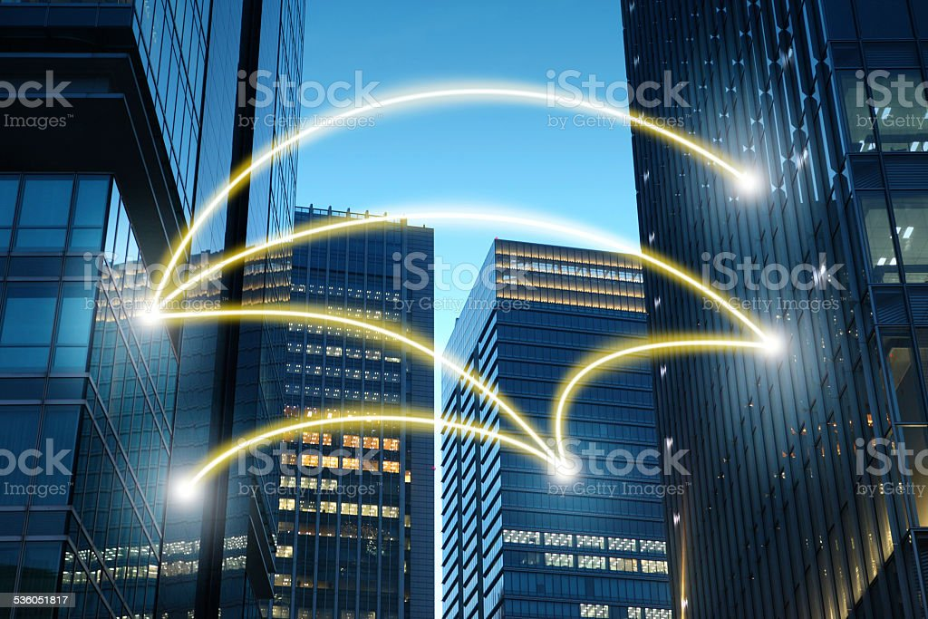 Futuristic city with buildings connected by cloud computing stock photo