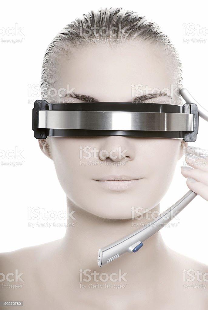 Futuristic cyber web operator wearing a futuristic headset royalty-free stock photo