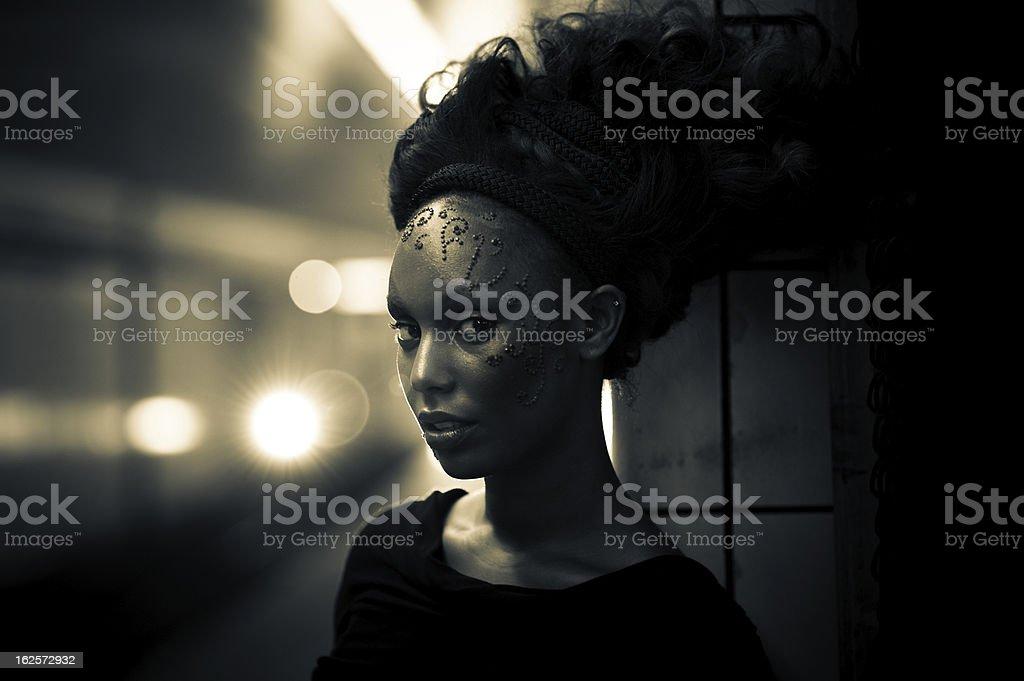 Futuristic Decorated Woman on Subway Platform stock photo