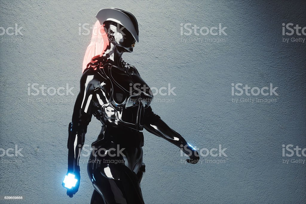 Futuristic female cyborg model in the street stock photo