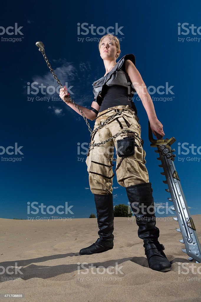 Futuristic female soldier in post-apocalyptic desert wasteland royalty-free stock photo