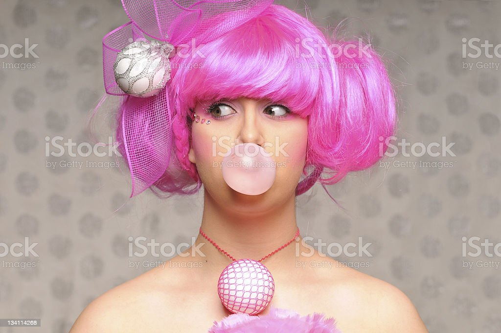 Futuristic girl blowing bubble gum royalty-free stock photo