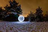 Futuristic glowing sphere on a background of a winter landscape