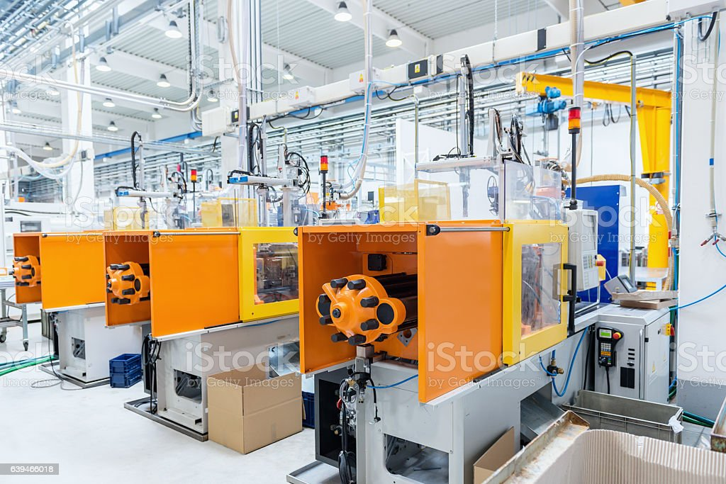 Futuristic injection moulding machines stock photo