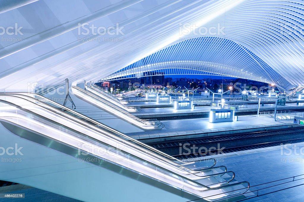 Futuristic Interior of Modern Railway Station Illuminated at Dusk stock photo