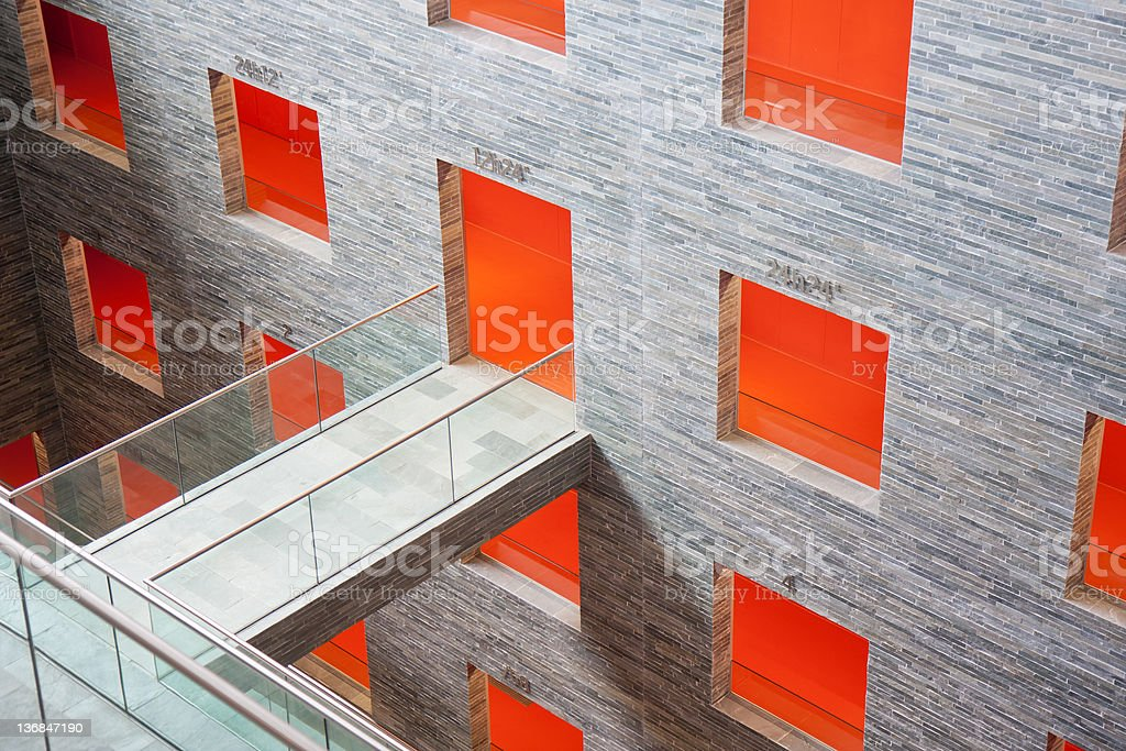 Futuristic interior with big orange rooms in a modern building royalty-free stock photo