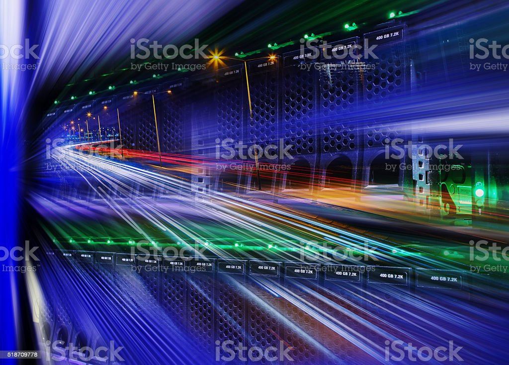 futuristic mix of disk storage, night city highway and blur stock photo