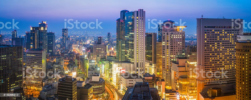Futuristic neon night cityscape panorama skyscraper sunset Umeda Osaka Japan stock photo