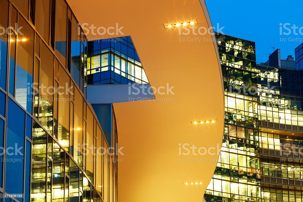 Futuristic Office Buildings Illuminated at Dusk royalty-free stock photo