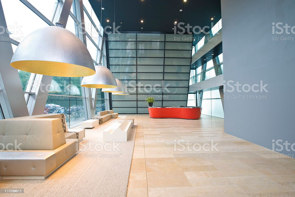 Futuristic office lobby with copious natural lighting stock photo