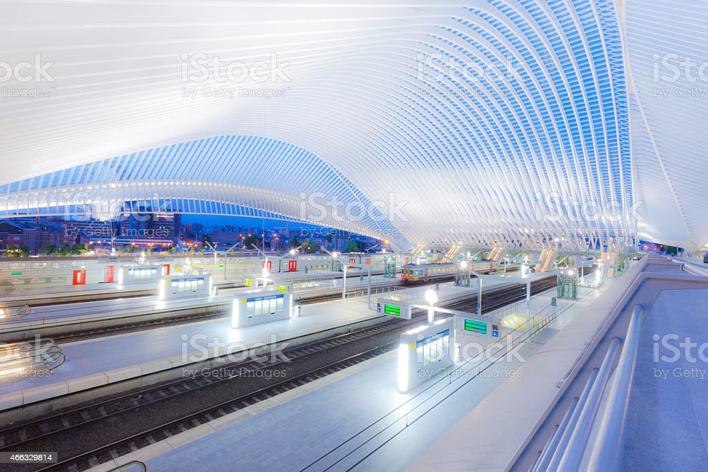 Futuristic Railway Station Building Illuminated at Night stock photo