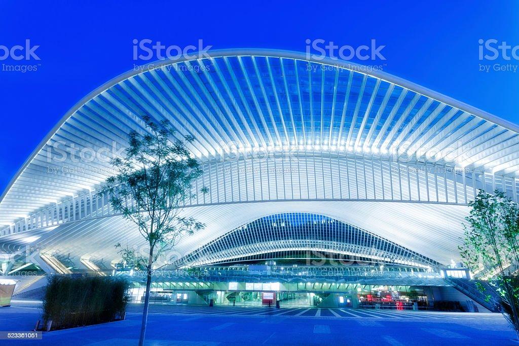 Futuristic Railway Station Building Illuminated at Night stock photo