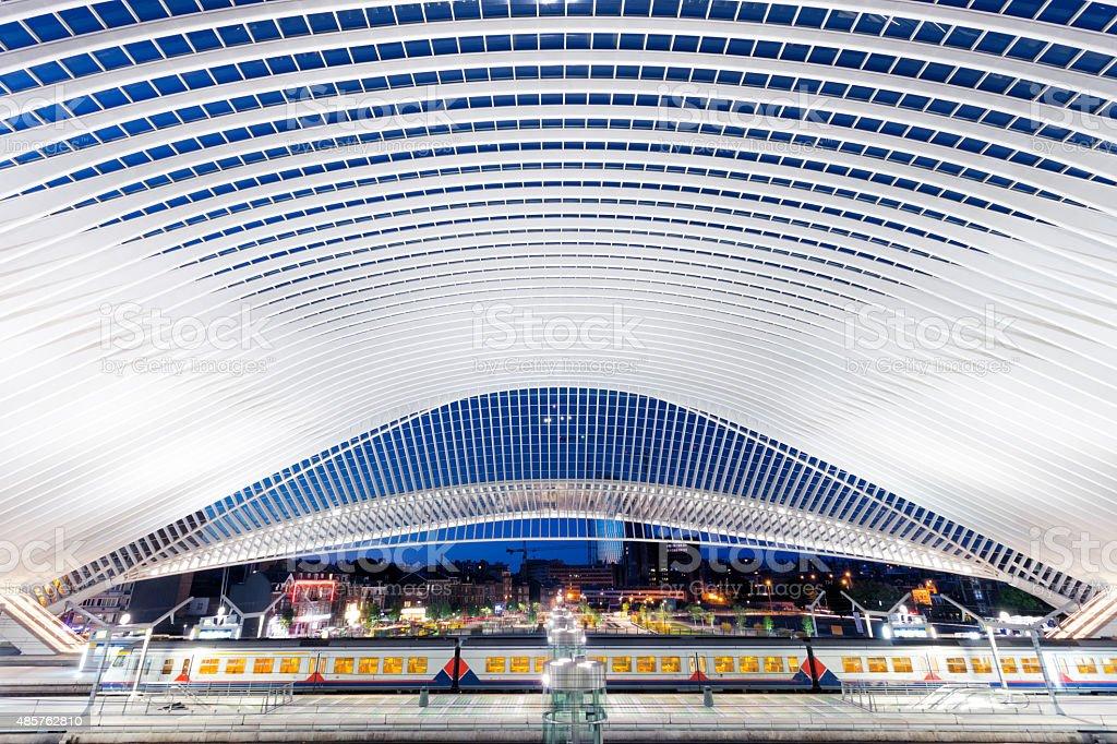 Futuristic Railway Station Illuminated at Night stock photo