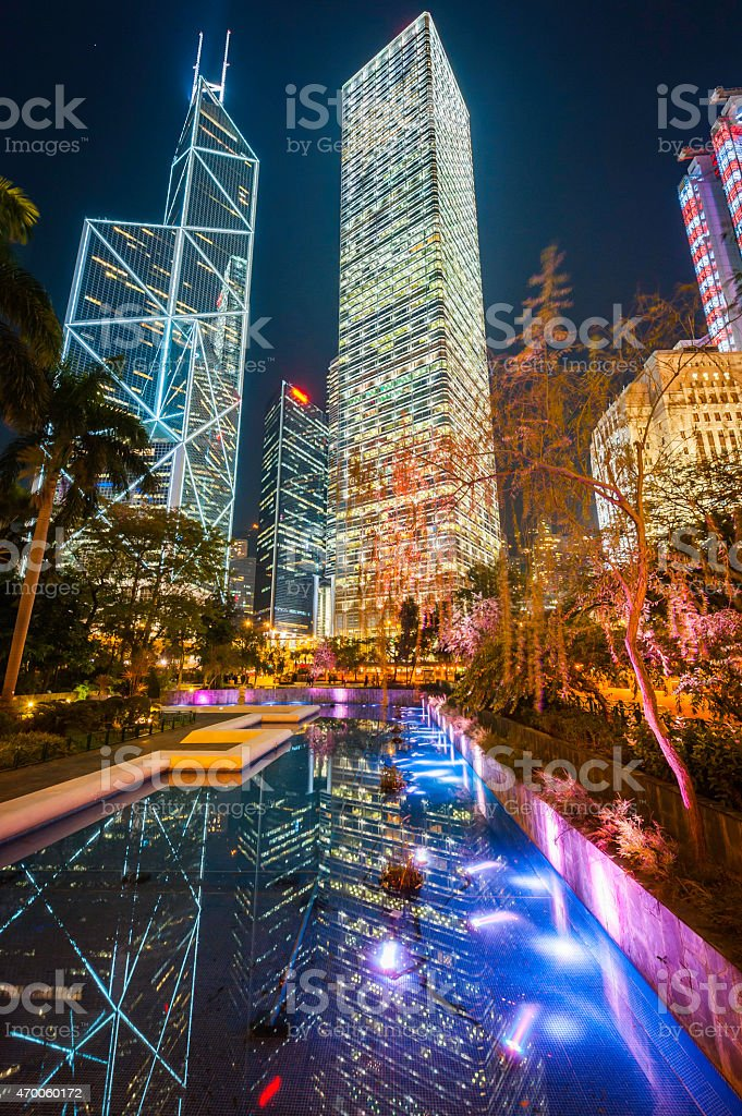 Futuristic skyscrapers glittering neon lights in night sky Hong Kong stock photo