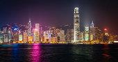 Futuristic skyscrapers illuminated neon night crowded cityscape Hong Kong China