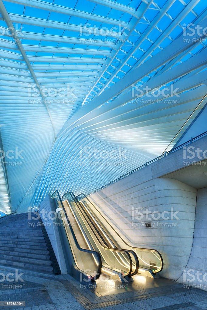 Futuristic Train Station Illuminated at Night, Liege Guillemins, Belgium stock photo