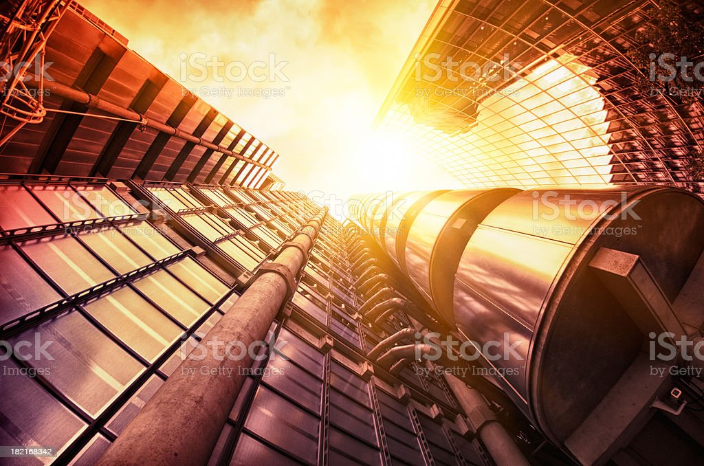 Futuristic tube steel building at dusk stock photo