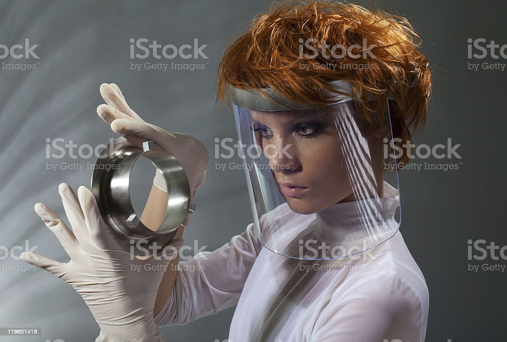 Futuristic woman examine metal detail stock photo