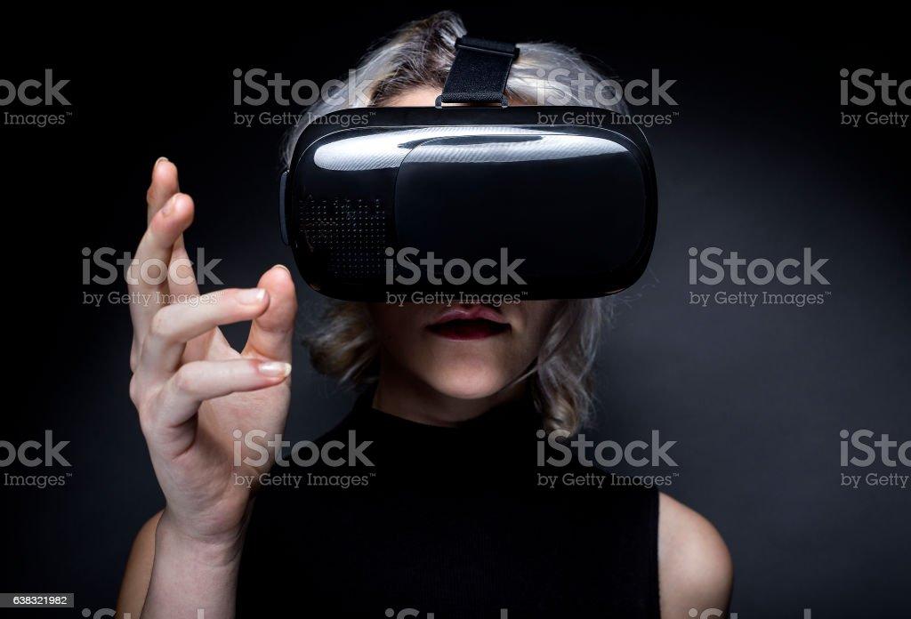 Futuristic Woman with Virtual Reality Headset stock photo