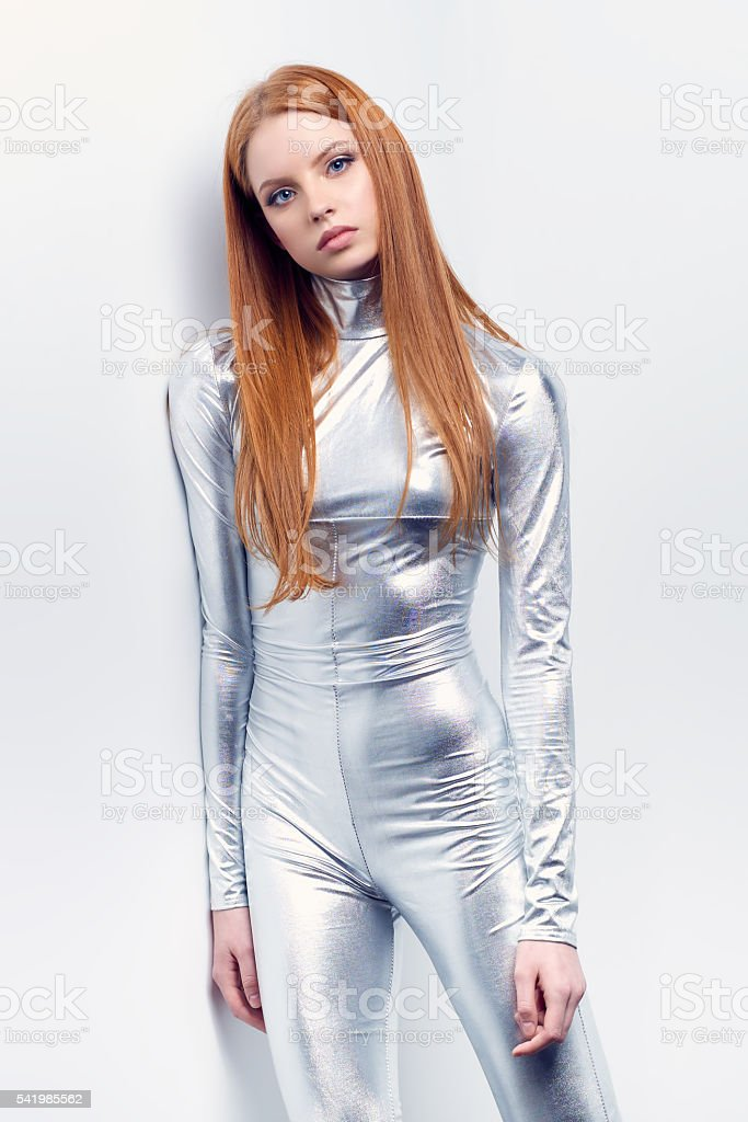 Futuristic young woman in silver clothing stock photo