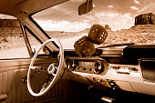 Fuzzy Mirror Dice, in classic car interior in sepia