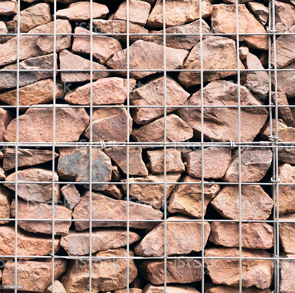 Gabion Wall - detail of rock fragments and wire container stock photo