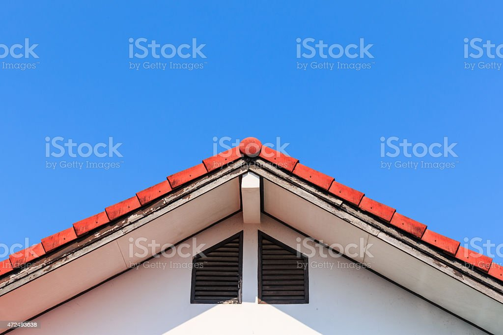 Gable of a House on blue sky background stock photo