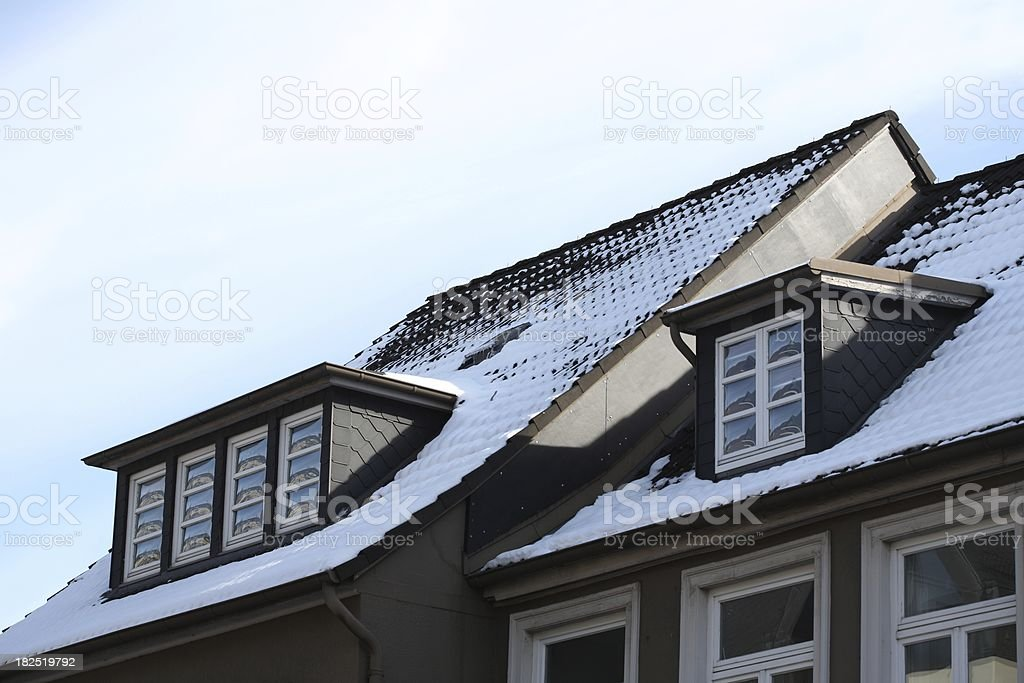 gabled with snow and isolated windows stock photo