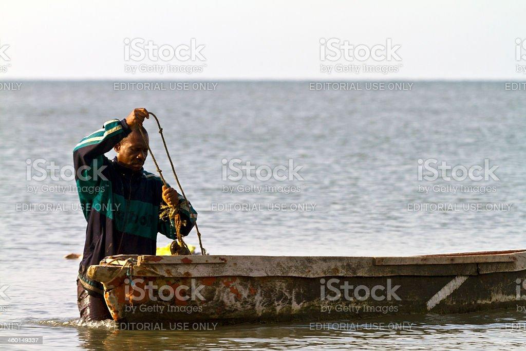 Gabon, Estuaire Province, fisherman and boat. stock photo
