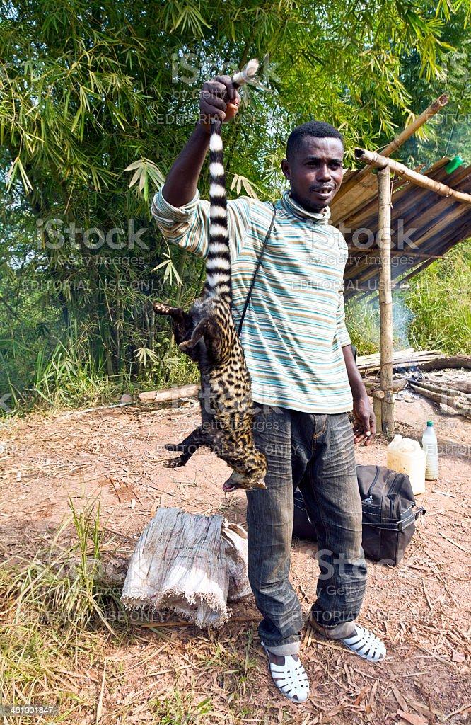 Gabon, Moyen-Ogooue Province, Lambaréné, man with palm civet. stock photo