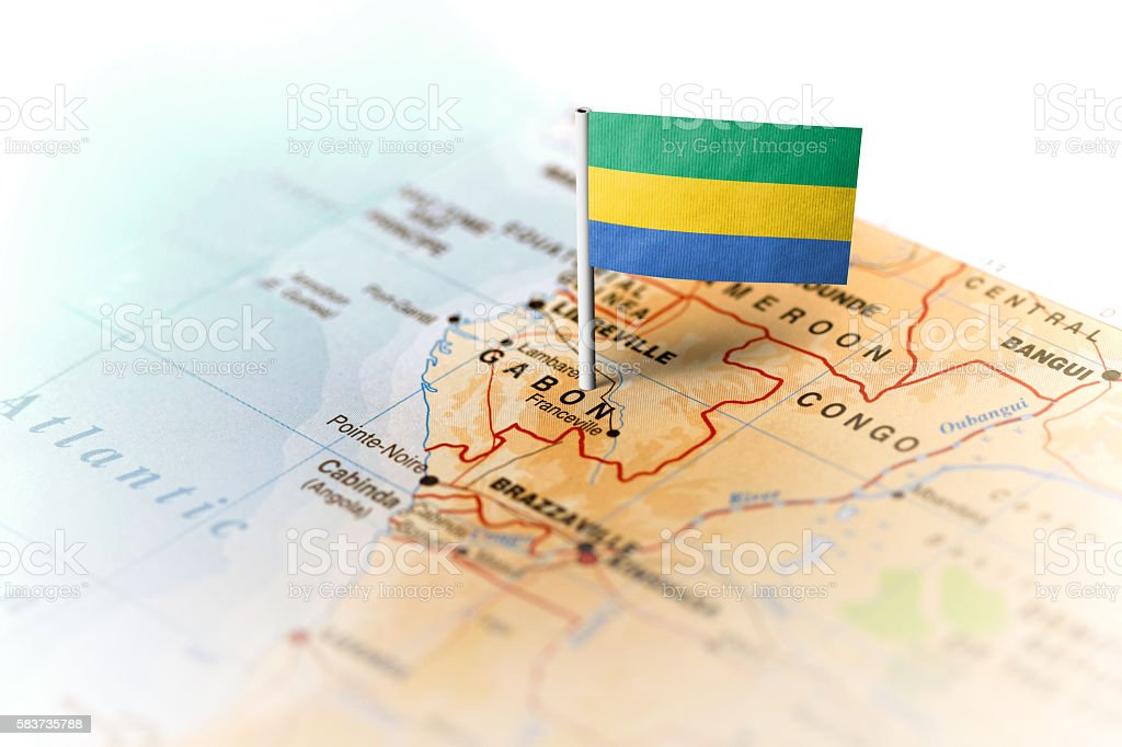 Gabon pinned on the map with flag stock photo