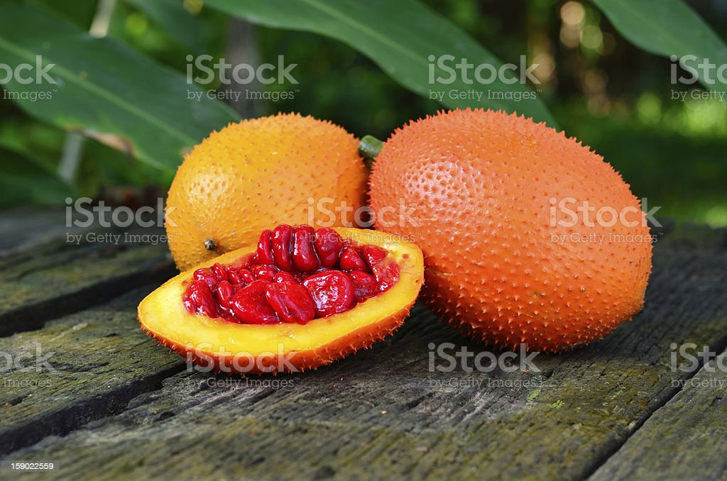 Gac Fruit(Spring Bitter Cucumber) on old wood background stock photo