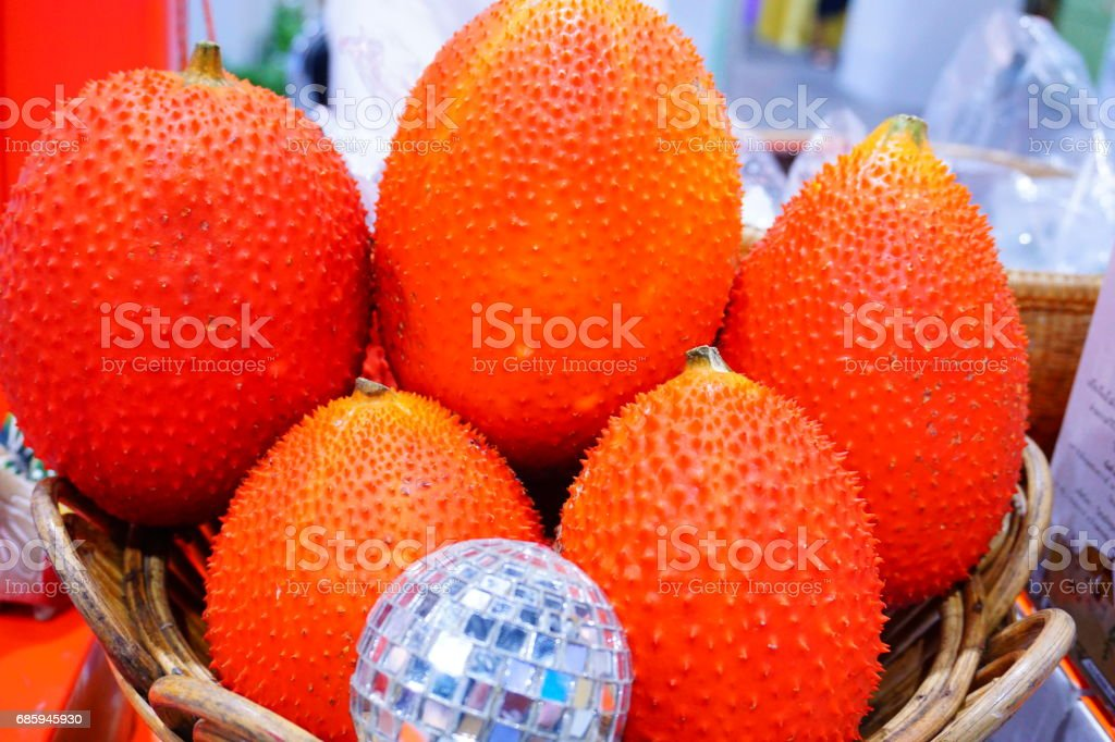 Gac fruit, typical of orange-colored plant foods in Asia with stock photo