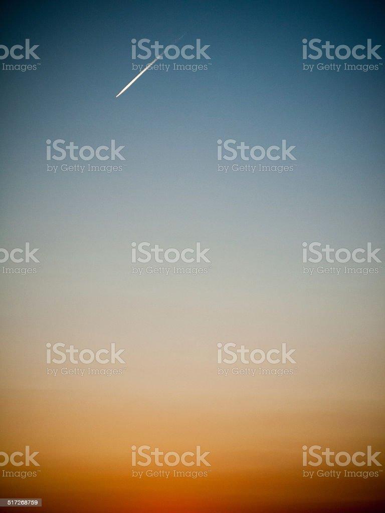 Gadient Sky with Jetplane stock photo