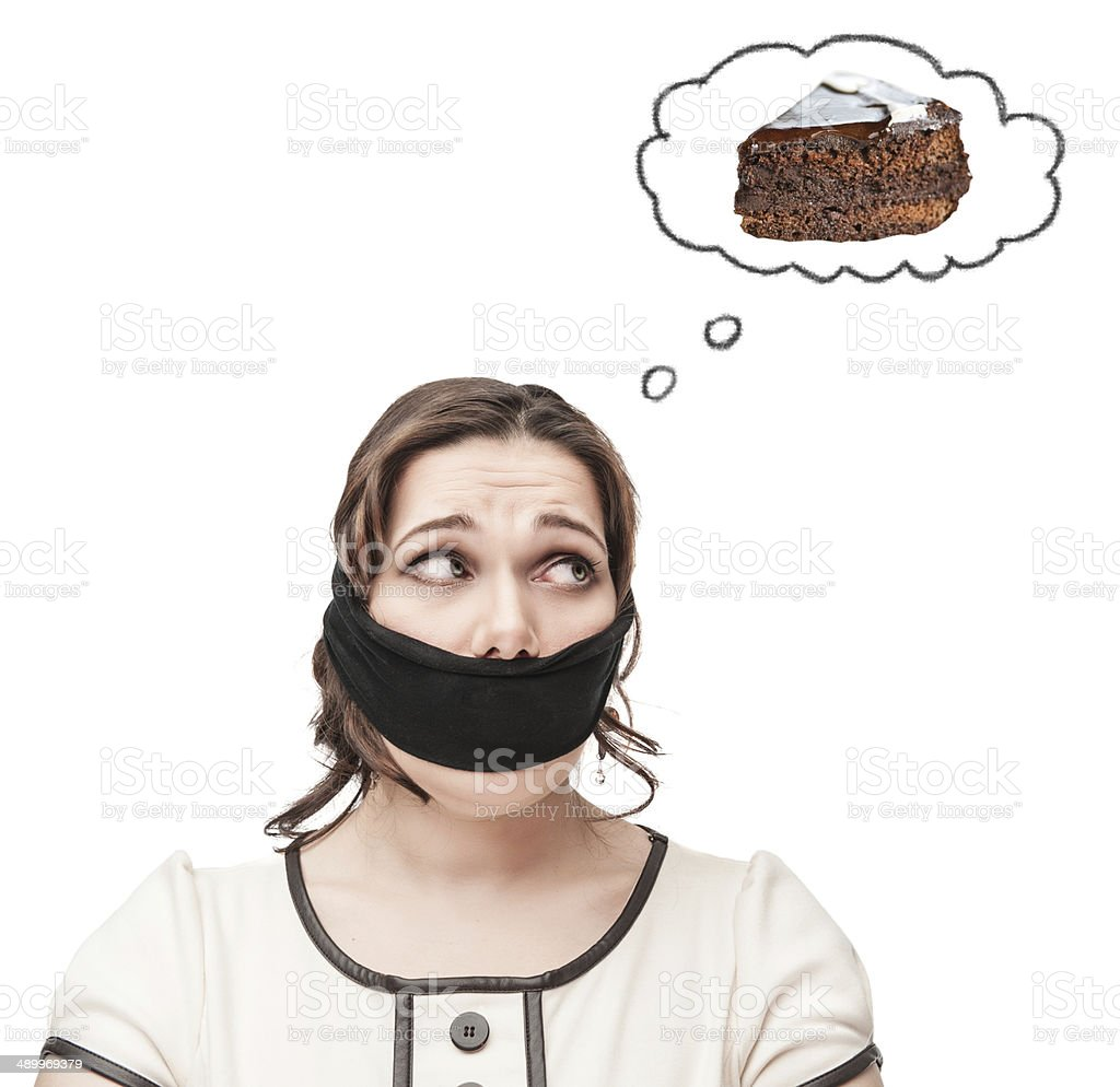 Gagged plus size woman dreaming about cake stock photo