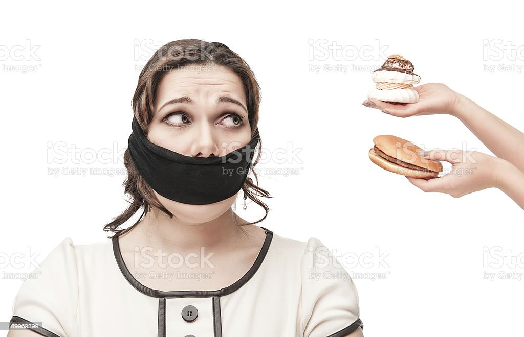 Gagged plus size woman seduced with junk food royalty-free stock photo