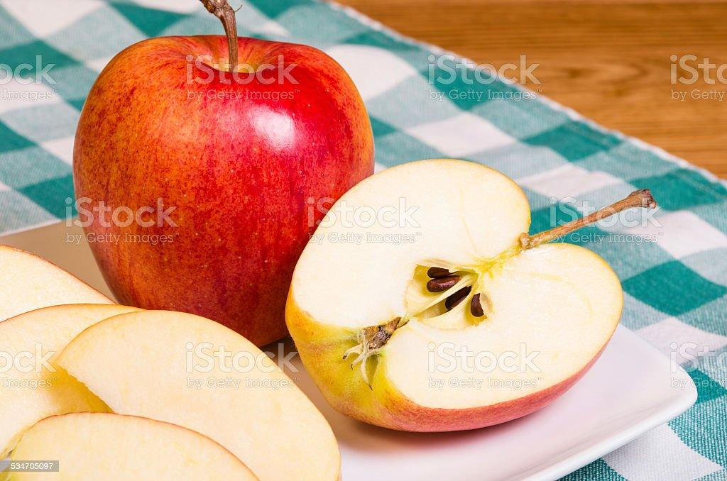 Gala apple sliced on a plate stock photo