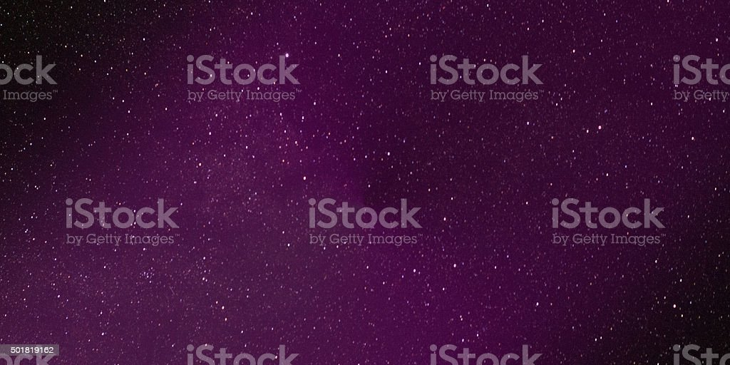 Galactic starry space - Purple colored stock photo