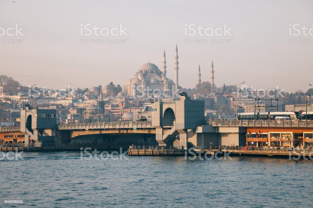 Galata Bridge and Suleymaniye Mosque in Istanbul, Turkey stock photo