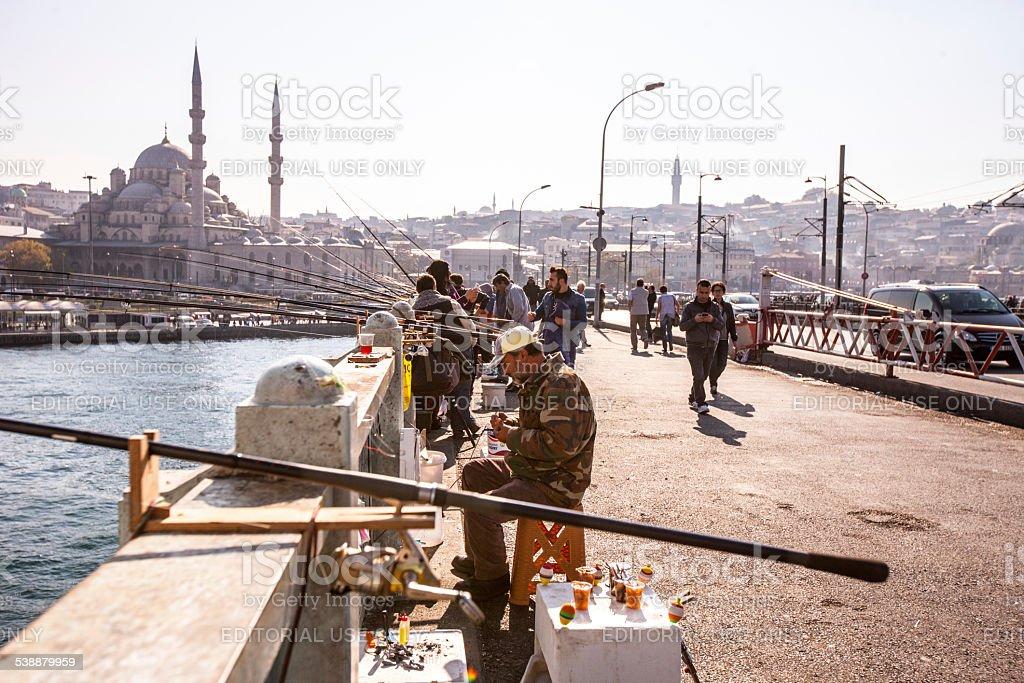 Galata Bridge Fishermen and New Mosque, Istanbul stock photo