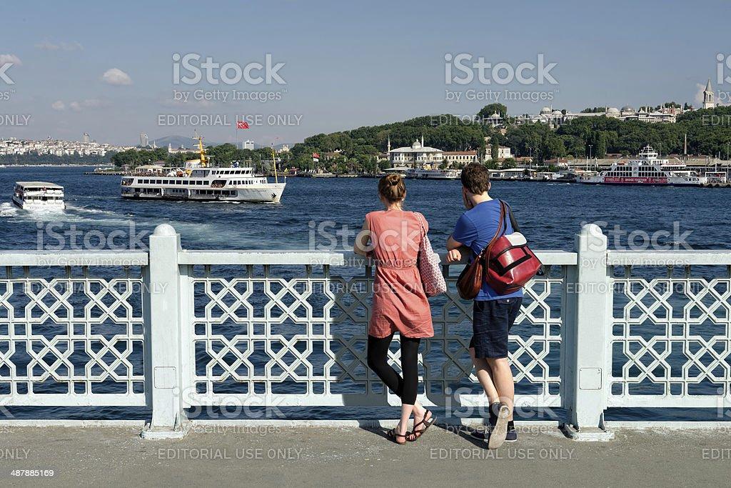 Galata Bridge, watching the scenery and sea transport tourists royalty-free stock photo