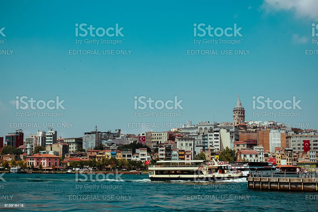 Galata Tower Buildings In Front Of River Against Sky stock photo