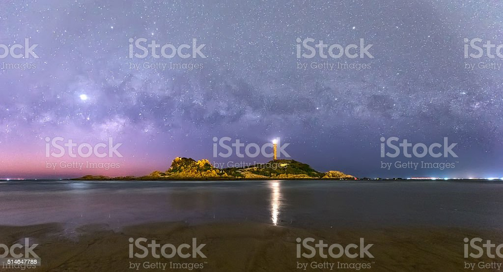 Galaxies inside old lighthouse at night stock photo