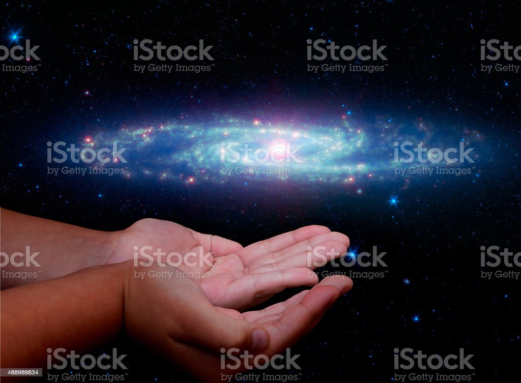 Galaxy in hands stock photo