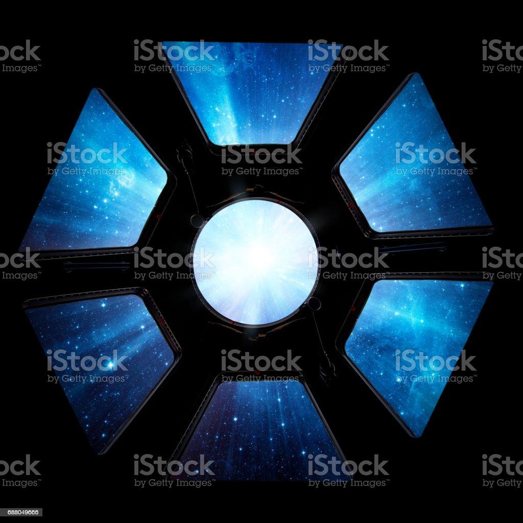 galaxy in spaceship window porthole. stock photo