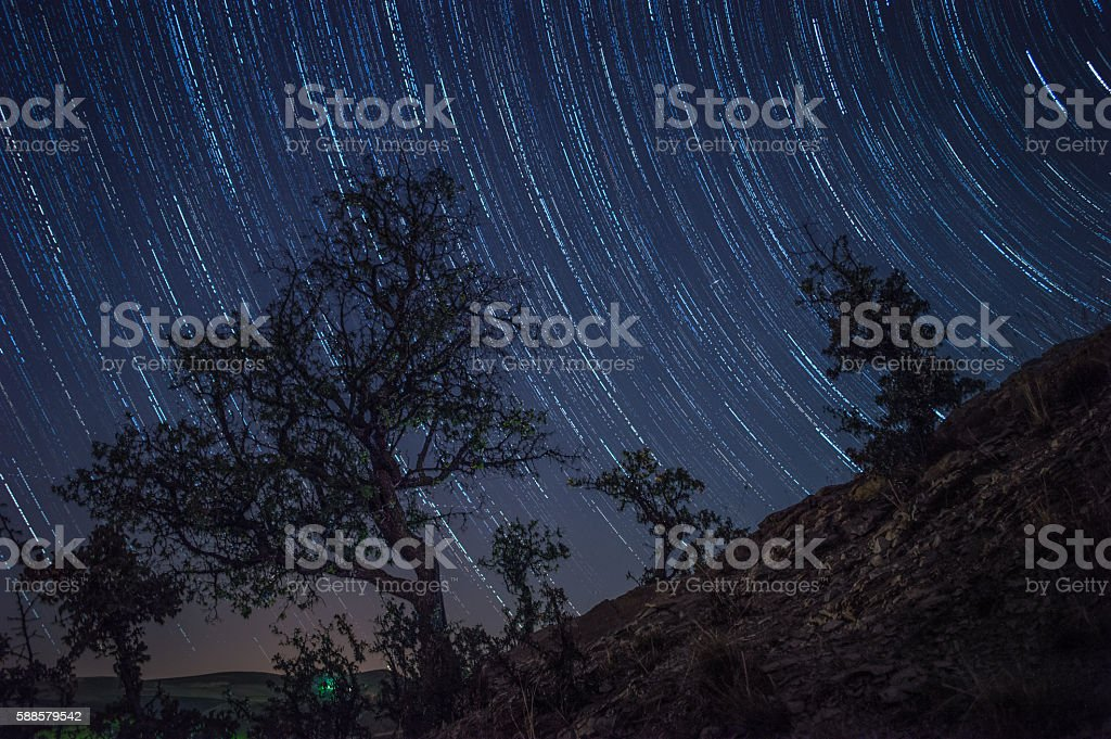 Galaxy mountain star trails stock photo