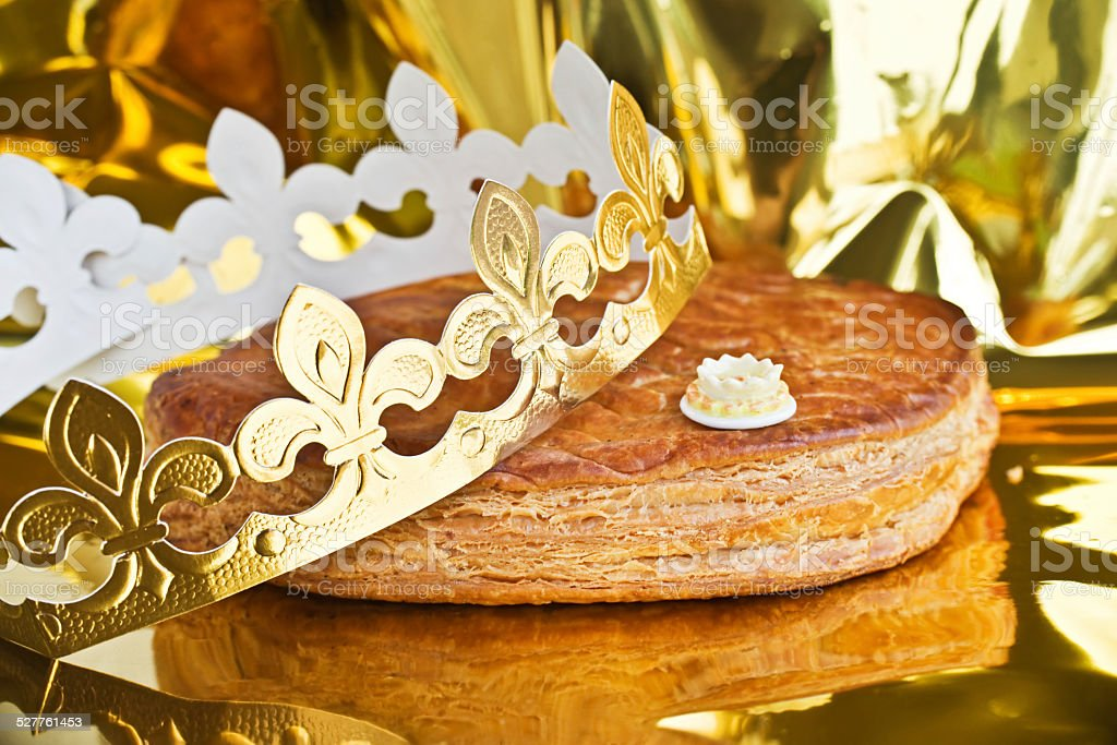 Galette des rois, french kingcake with a golden crown stock photo