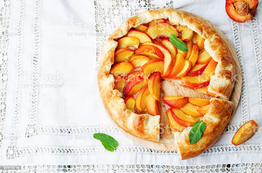 Galette with peaches stock photo